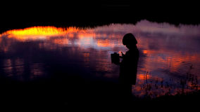 Silhouette of child beside the swamp Stock Photo