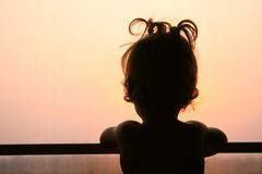 Silhouette of child in window Royalty Free Stock Images