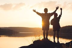 Silhouette of children backpack in nature. Relax time on holiday concept travel,selective and soft focus,tone of hipster style stock photo