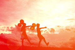 Silhouette children with balloon Stock Photography