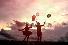 Silhouette children with balloon Royalty Free Stock Photography