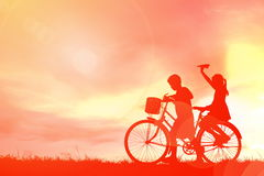 Silhouette children and bicycle stock photography