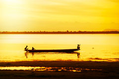 Silhouette of children on  boat Royalty Free Stock Image