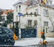 Silhouette of children crossing street on a snowy day diver. Silhouette of child kid on bike crossing street on a snowy day - senn by the driver point ov view royalty free stock photo