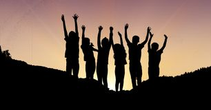 Silhouette children with hands raised on mountain during sunset Stock Images