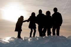Silhouette of children on Ice hummocks at sunset Royalty Free Stock Images