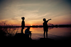 Silhouette children playing happy time at sunset Royalty Free Stock Image