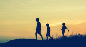 Silhouette children playing happy time at sunset royalty free stock photo