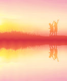 silhouette children playing happy time at sunset with water refl Stock Photo