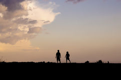 Silhouette of children running  Royalty Free Stock Image