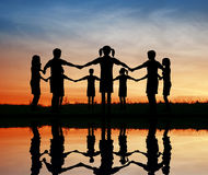 Silhouette children. sunset pond. Royalty Free Stock Image
