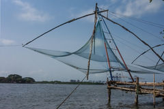 Chinese Fishing Nets in Kochi. Silhouette of Chinese Fishing Nets in Kochi, India Stock Photos