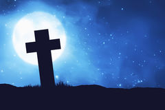 Silhouette christian cross shape on the field stock photos