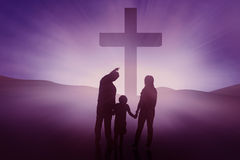 Silhouette of Christian family. On blue background, horizontal shot Stock Photography