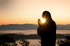 Silhouette of christian man hand praying,spirituality and religion,man praying to god. Christianity concept stock photo