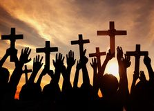 Silhouette of Christians holding crosses Royalty Free Stock Images