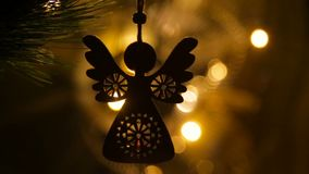 Silhouette of a Christmas eco toy on a bokeh background stock video footage