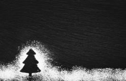 Silhouette of a Christmas tree drawn with white flour royalty free stock photography
