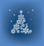 Silhouette of Christmas tree formed by snowflakes Royalty Free Stock Photos