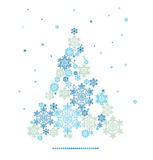 Silhouette of Christmas tree formed by snowflakes Stock Images