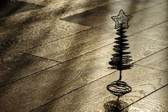 Silhouette of the christmas tree on a wooden floor Stock Photos