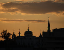 silhouette of church and mosque Stock Photo