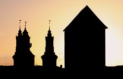 Silhouette Church and Tower. Silhouettes of a Church and a huge Tower royalty free stock photos