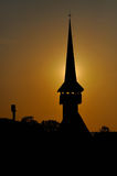 Silhouette of a church tower in the sunset Royalty Free Stock Photo