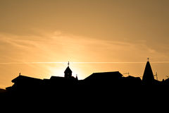 Silhouette of church towers Stock Photos