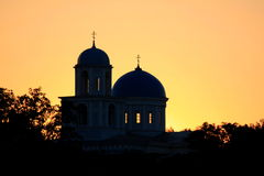 Silhouette of churches on a golden sky Stock Images