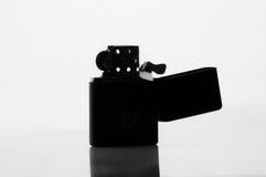 Silhouette of a cigarette lighter Stock Photo