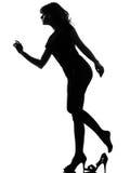 Silhouette Cinderella woman losing her shoe Stock Photos