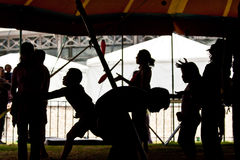 Silhouette of circus performers practicing before. Silhouette of circus performers practicing juggling before the show Stock Photos