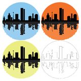 Silhouette of the city on a colored background Stock Photos