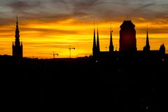 Silhouette of the city of Gdansk in the incredible sky at sunset. Poland.  Royalty Free Stock Image