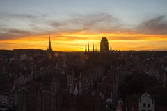 Silhouette of the city of Gdansk in the incredible sky at sunset. Poland.  Stock Image