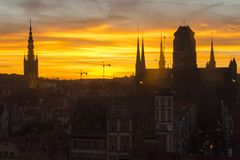 Silhouette of the city of Gdansk in the incredible sky at sunset. Poland.  Royalty Free Stock Images