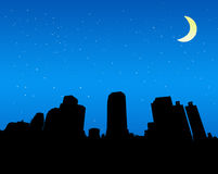 Silhouette of the city at night. With star and moon Vector Illustration
