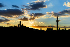 Silhouette of the city of Siena at sunset Royalty Free Stock Images