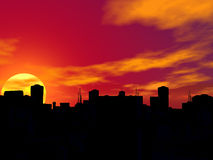Silhouette of a city in sunset. Stock Image