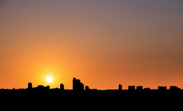 Silhouette, city in sunset with clear sky in tropical country Stock Photography