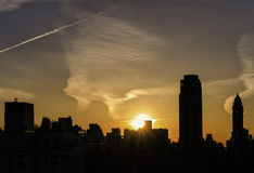 Silhouette of City at Sunset, New York. A skyline of the upper east side of New York City at sunset, with tall buildings in silhouette, outlined  against the Royalty Free Stock Photo