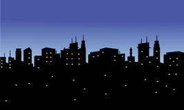 Silhouette of city with twinkling lights Stock Images