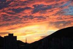 Silhouette Cityscape Against Dramatic Sky during Sunset Stock Photo