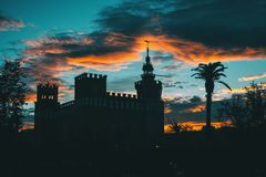 Silhouette of ciutadella garden over colorful sunset sky stock images