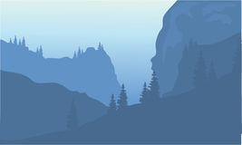 Silhouette of cliff and forest. At morning Stock Image