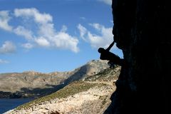 Silhouette of a climber. Silhouette of a rock climber near the sea Royalty Free Stock Photo