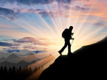 Silhouette climber ascending to the top of the mountain Royalty Free Stock Image