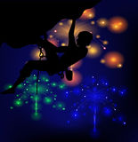 Silhouette of a climber on a background of fireworks. Silhouette of a climber on a background of lights fireworks Stock Image