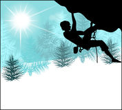 Silhouette of a climber on a background of  winter landscape Stock Photography